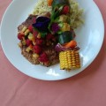 Cajun dusted Veal scallopini with raspberry tropical fruit salsa. Lemon zest brown rice pilaf. Grilled vegetable towers.